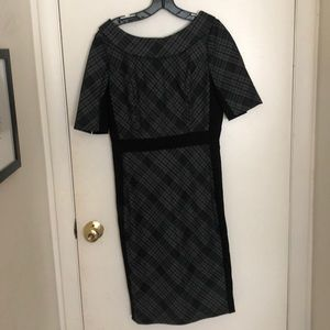 Black and gray plaid dress with mock collar.